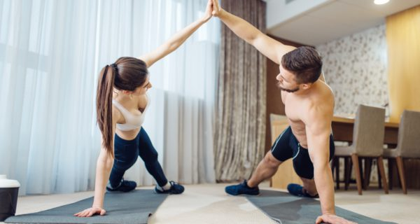 Morning fit workout of love couple at home