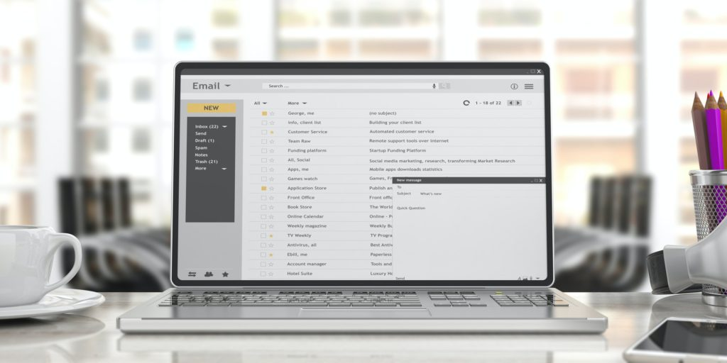 Emails on a laptop screen isolated on an desk, office background. 3d illustration